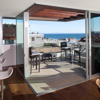 Balcony - contemporary balcony idea in Los Angeles with a pergola