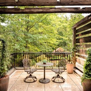 Inspiration for a country metal railing balcony in Atlanta with a potted garden and a pergola.