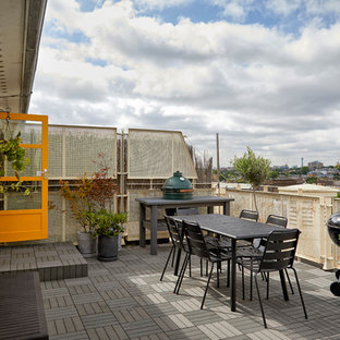 Large midcentury metal railing balcony in London with no cover and a fire feature.