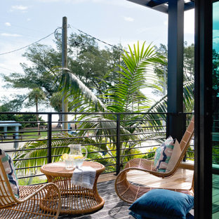 Mid-sized minimalist metal railing balcony photo in Tampa with a roof extension
