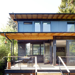 Medium sized contemporary balcony in Seattle with a roof extension.
