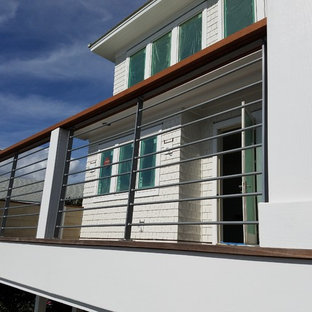 Photo of a large contemporary metal railing balcony in Other.
