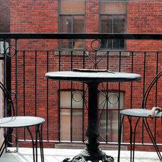 Traditional Porch by Laura Garner
