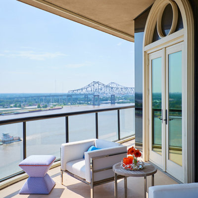 Example of a mid-sized trendy balcony design in New Orleans with a roof extension