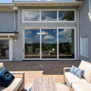 Open-Air Living with Large Glass Multi-Slide Patio Door x Transom Combination