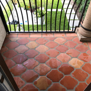 Inspiration for a small mediterranean metal railing balcony in Houston.