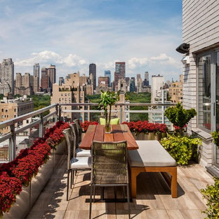 Example of a mid-sized minimalist balcony design in New York with no cover