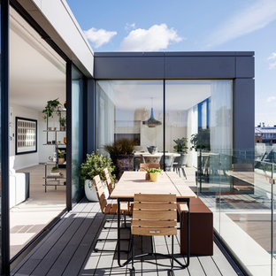 Inspiration for a small contemporary glass railing terrace and balcony in London with no cover.