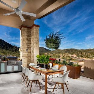 Ispirazione per un balcone stile americano di medie dimensioni con un tetto a sbalzo, un giardino in vaso e parapetto in cavi