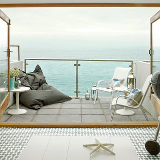 Design ideas for a small nautical terrace and balcony in Cornwall with no cover.