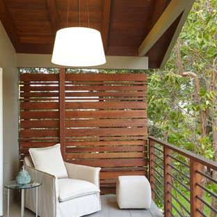 Example of a transitional privacy balcony design in San Francisco with a roof extension