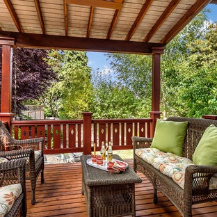 Inspiration for a craftsman wood railing balcony remodel in Seattle with a roof extension