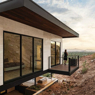 Balcony - contemporary cable railing balcony idea in Phoenix with a roof extension