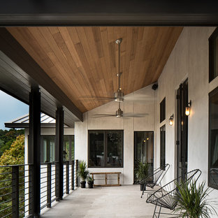 Balcony - contemporary balcony idea in Austin with a roof extension