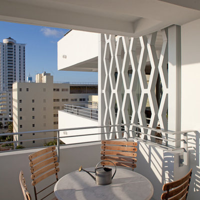 Balcony - contemporary apartment balcony idea in Miami with a roof extension