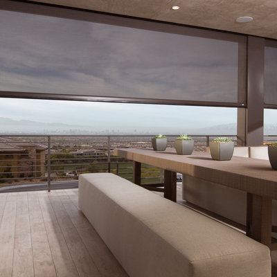 Large trendy balcony photo in Sacramento with a roof extension