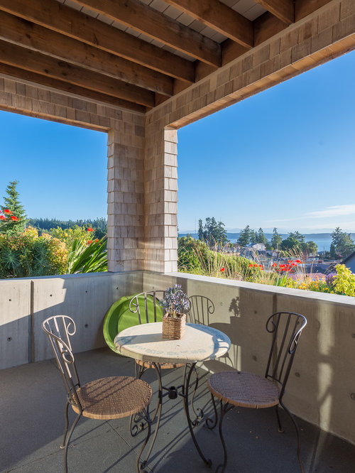 Inspiration For A Transitional Balcony Remodel In Seattle With A Roof  Extension