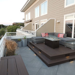 Inspiration For A Small Modern Metal Railing Balcony Remodel In Other With Fire Pit