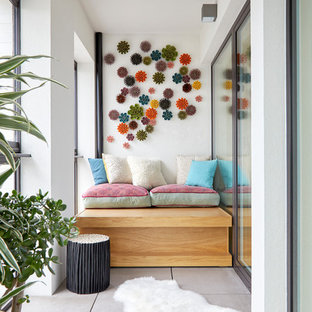 Inspiration for a medium sized contemporary terrace and balcony in London with a roof extension.