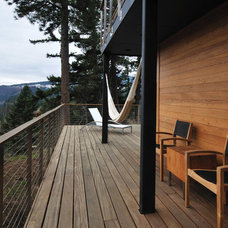 Rustic Porch by Encircle Design and Build