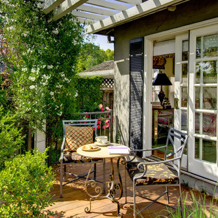 Inspiration for a mid-sized timeless privacy balcony remodel in San Francisco with a pergola
