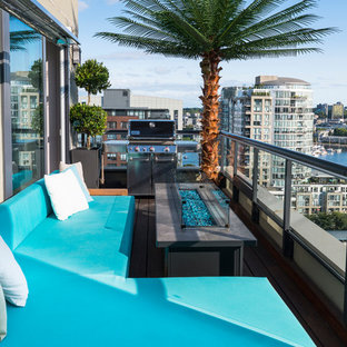 Small Coastal Gl Railing Balcony Photo In Vancouver With A Fire Pit