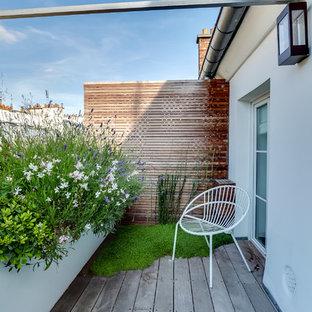 Inspiration pour une petite terrasse et balcon design avec aucune couverture et des solutions pour vis-à-vis.