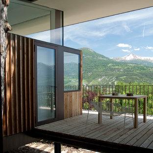 Idées déco pour une petite terrasse et balcon montagne avec une extension de toiture.