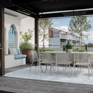 Mid-sized contemporary balcony in Sydney with an awning and metal railing.