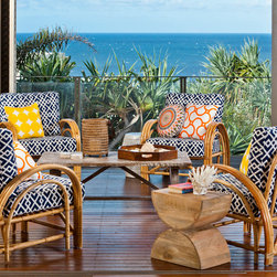 Navy graphic weave outdoor fabric used on these stunning cane chairs