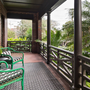 This is an example of a small tropical balcony in Sydney with an awning.