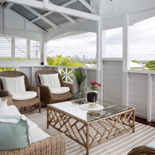 Design ideas for a beach style balcony in Brisbane with a roof extension.