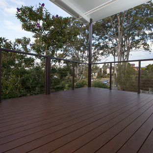 Large contemporary wire cable railing terrace and balcony in Sydney with a pergola.