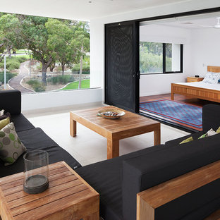 Photo of a large contemporary balcony in Perth with a roof extension.