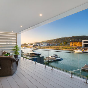 Photo of a mid-sized beach style balcony in Melbourne.