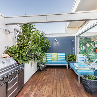 Design ideas for a large beach style balcony in Sydney with a container garden and no cover.