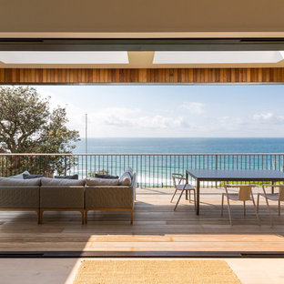 Photo of a large contemporary balcony in Sydney with a pergola.
