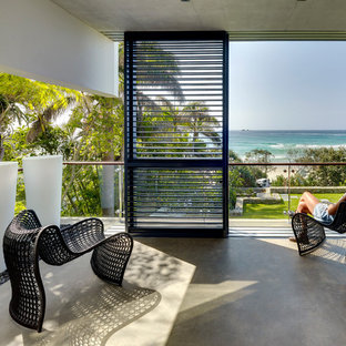 Photo of a mid-sized contemporary balcony in Gold Coast - Tweed with with privacy feature.