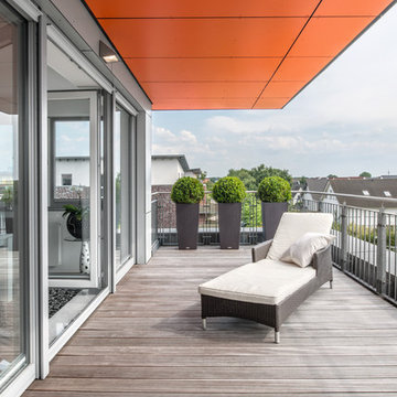 Mehrfamilienhaus W18 mit Penthouse und orangefarbenen Dach