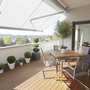 Mittelgroße Moderne Terrasse mit Markisen in Stuttgart
