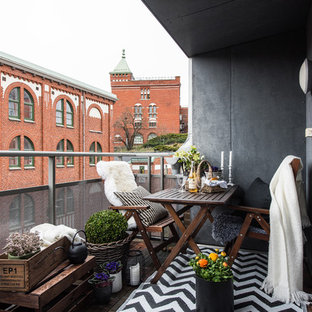 Design ideas for a medium sized scandi terrace and balcony in Gothenburg with an awning.