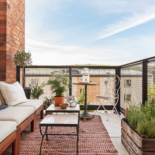 Small scandinavian terrace and balcony in Stockholm with no cover.