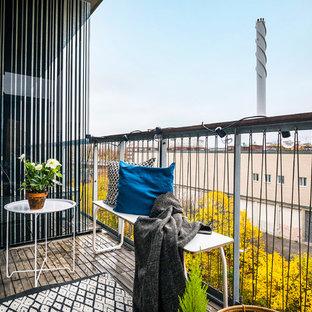 Inspiration för små moderna balkonger, med kabelräcke och takförlängning