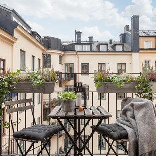 Idées déco pour une grande terrasse et balcon scandinave.