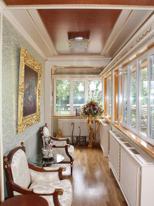 Best victorian sunroom with medium tone hardwood floors for Victorian sunroom