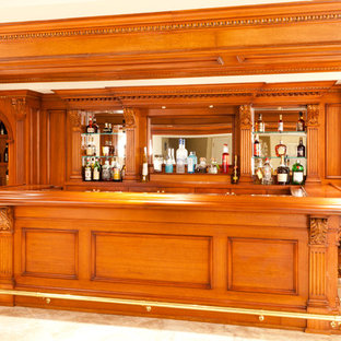 Design ideas for a traditional home bar in New York.