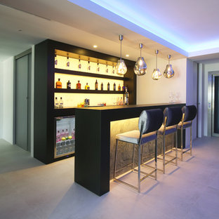 Mid Sized Minimalist Single Wall Seated Home Bar Photo With Open Cabinets  And Black
