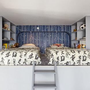 Inspiration för ett litet funkis pojkrum kombinerat med sovrum och för 4-10-åringar, med blå väggar