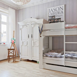 Example of a large cottage chic girl light wood floor and beige floor kids' room design in Malmo with purple walls