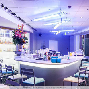 This is an example of a contemporary home bar in Nancy.